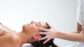 woman receiving a osteopathic head massage
